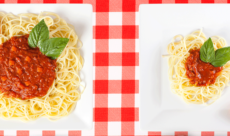 large and small plates of spaghetti