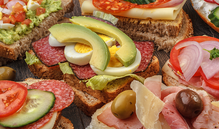 sandwiches with variety of meats and toppings